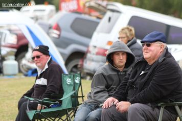 Dave Holmes (right), from Waimate, watches the track action