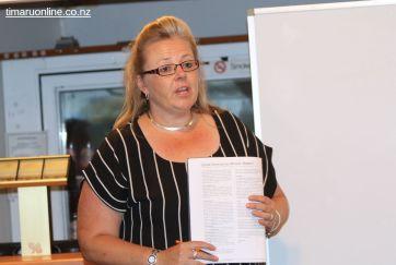 SCRFU board member, Michelle Martin, speaks to the Annual Financial Report.