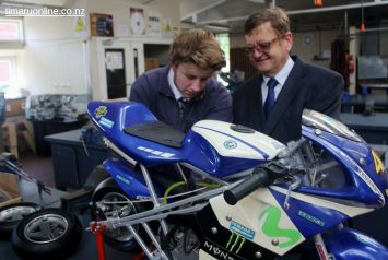 Ethan Shields and Michael Howard (Head of Technology) work on a mini-motorcycle project