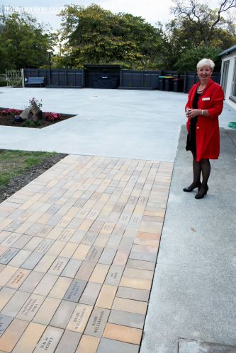 Rose Davidson (Alzheimers SC Staff) and the brick pathway acknowledging donations