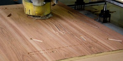Patterns being cut into a piece of FSC plywood.