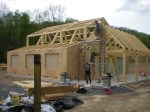 SIPs going on to the timber frame shell.