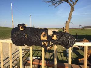 three railing bears