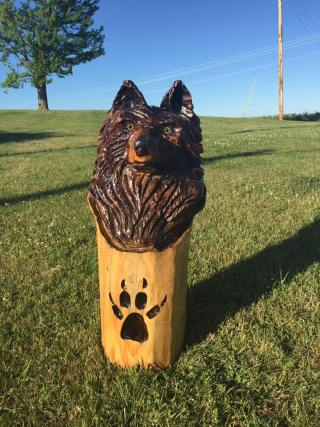 wolf head with paw print