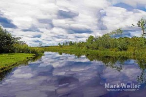 Timestack photography of clouds over river reflection