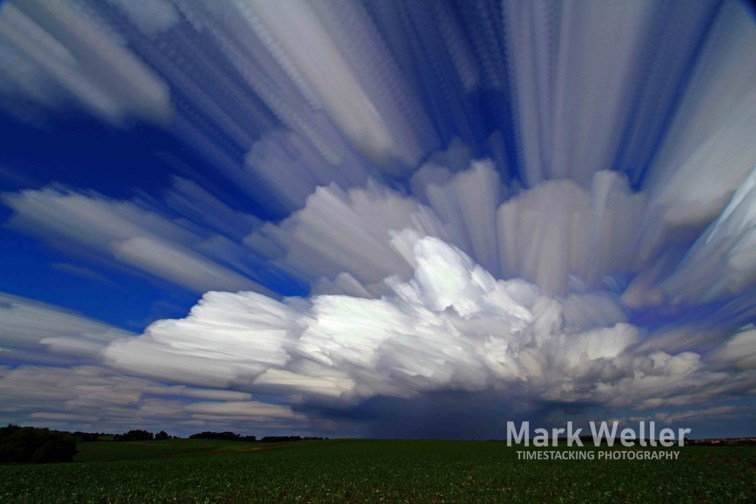 Timestack photography of rain cloud over field summer