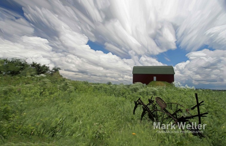 Timestack photography of clouds over farm