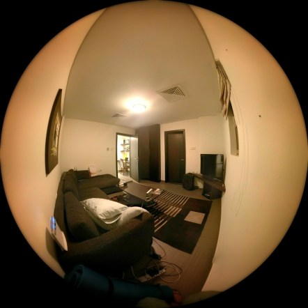 Day 206 So, in just over a week's time we'll be leaving our first home in Bahrain for a whole new place. Here's a silly phone done fish eye photo of our current living room. A bit messy and very dark. The darkness being one of the big reasons why we're moving.