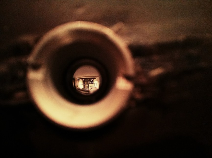 Day 209 Peering through the peep hole in the front door. Our flat's on the first floor and it gets a wee bit noisy sometimes.