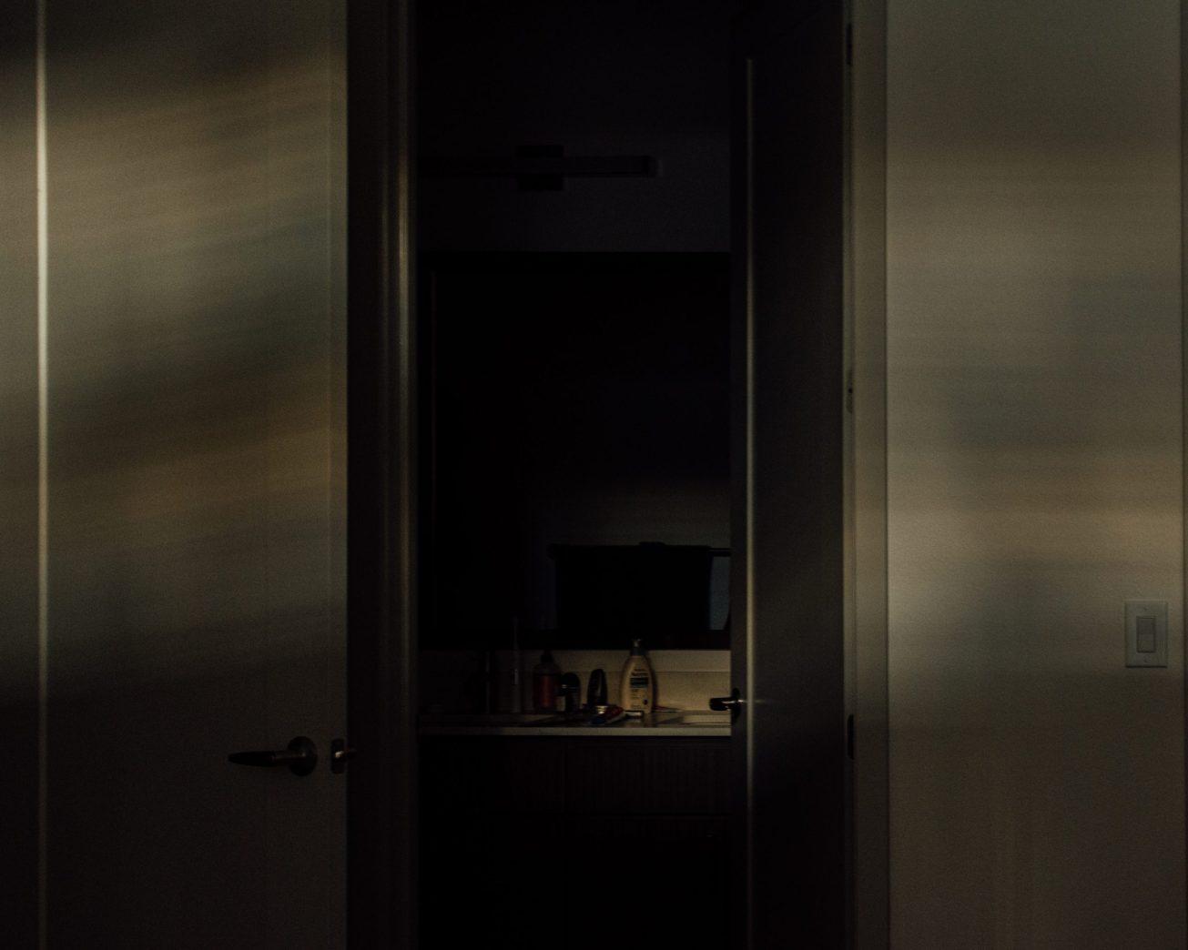 Photo of a door open to a bathroom.