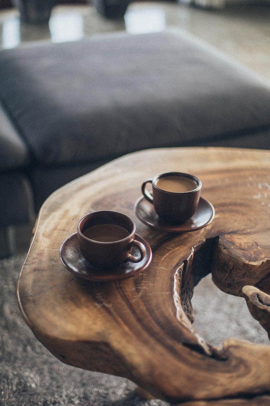 two brown ceramic mugs