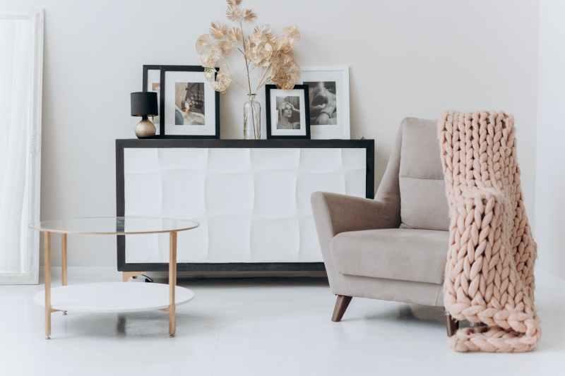 beige sofa chair near a table