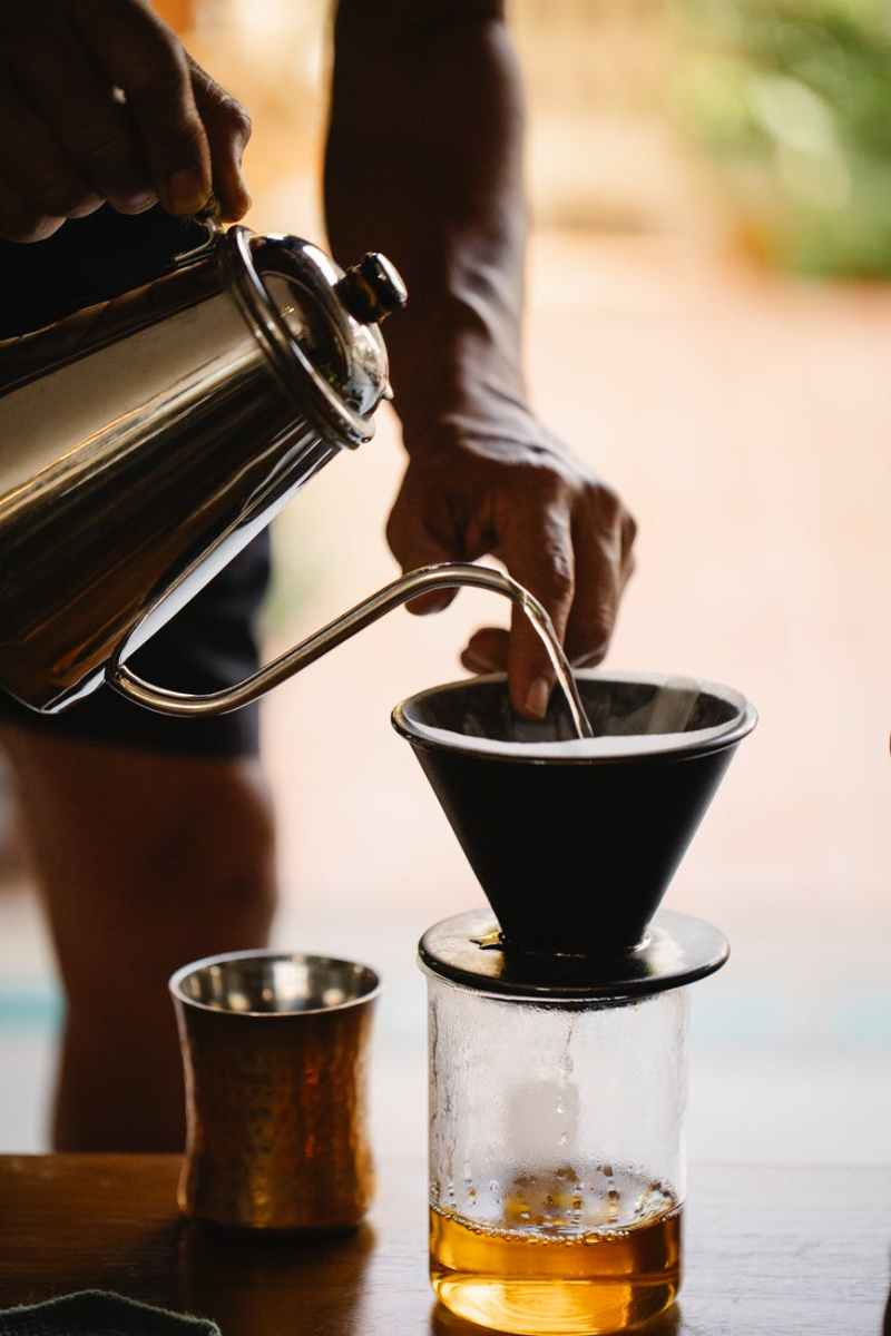 anonymous barista making pour over coffee