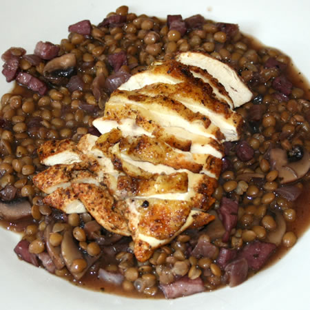 Grilled chicken on green lentils