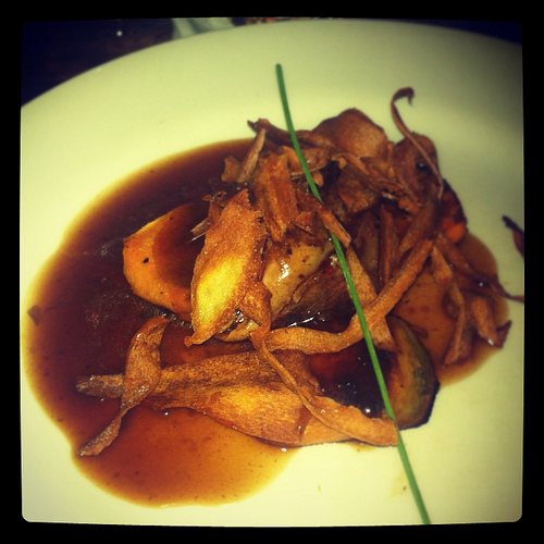 pigeon breast, roasted pink and served with sweet potato, a red wine jus and parsnip chips