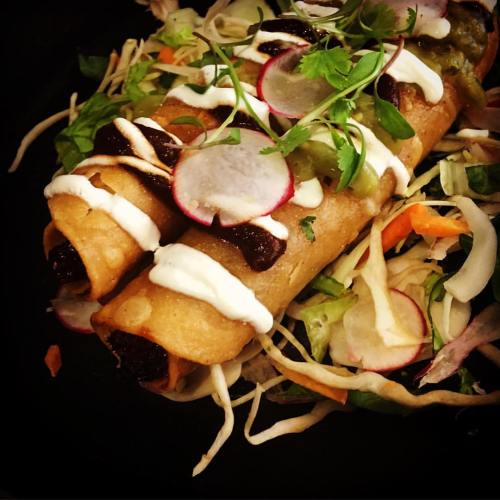 slow-braised lamb shoulder marinated in ancho chilli and orange rolled in a crispy fried tortilla