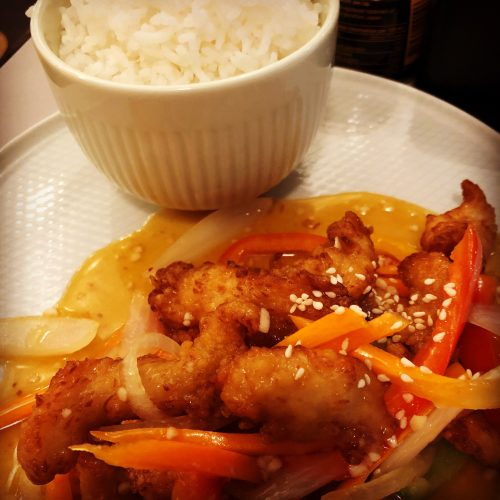 Go Lo Gai, Sweet & Sour Crispy Chicken in an Orange, Lemon, Ginger & Garlic Sauce with Green Peppers & Onions.