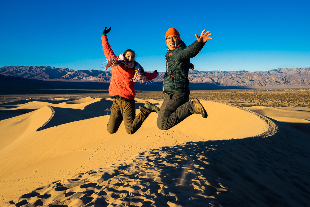 Jumping for joy at the highest point of the Mesquite Dunes.