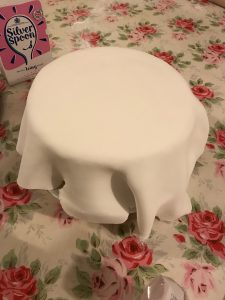 Cake with fondant draped over that looks like a ghost