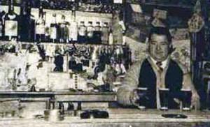 Ald Wright behind the bar of the Dora Dora Hotel