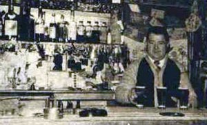 Ald Wright behind the bar of the Dora Dora Hotel