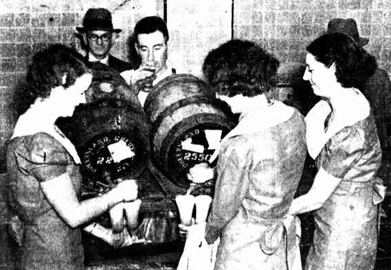 barmaids pouring draught beer 1937