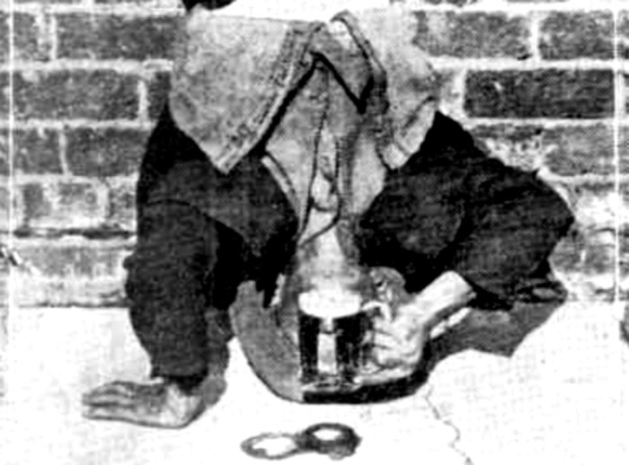 drinking beer on head 1930 front