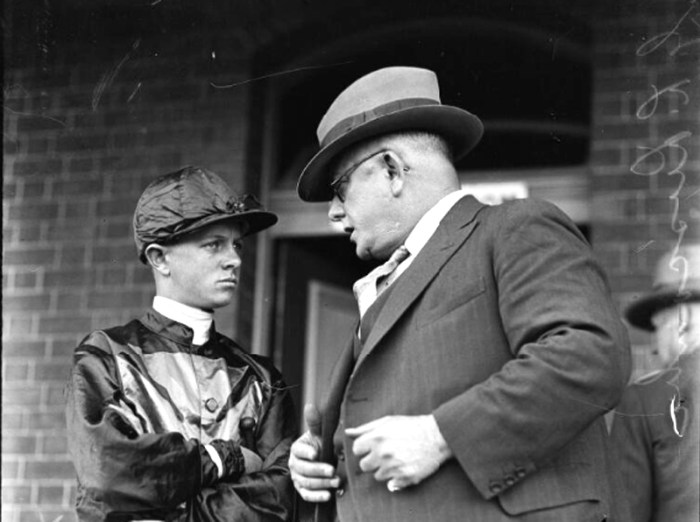 jockey E Britt speaking to Mr G S Luscombe at races New South Wales 12 October 1932 Fairfax Media