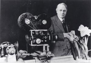 Arthur C. Pillsbury posing next to his lapse-time camera
