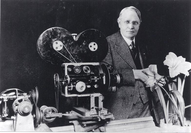Arthur C. Pillsbury posing next to his lapse-time camera