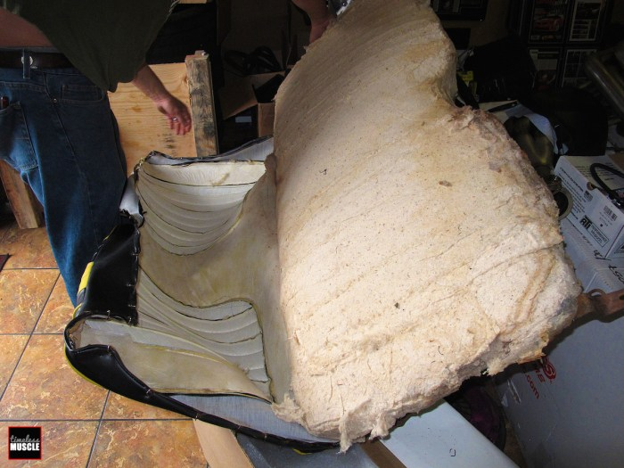 The back seat disassembles in a similar fashion to the front seats, cutting the old hog rings off then pulling the old seat covers away from the seat foam.