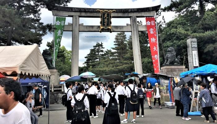 Kyoto Markets: Tenjin-san Market at Kitano Tenmangu Shrine is a popular destination for students.