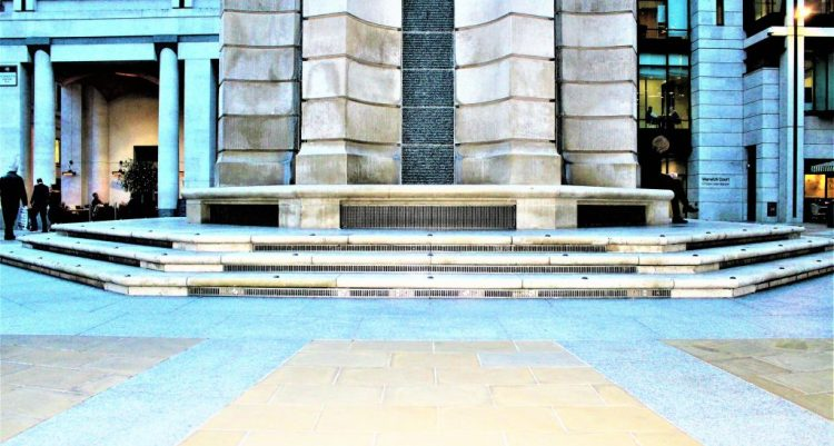 Paternoster Square: The hexagonal stone base of Paternoster Column shows grates under the steps which allows for ventilation for the car park beneath.