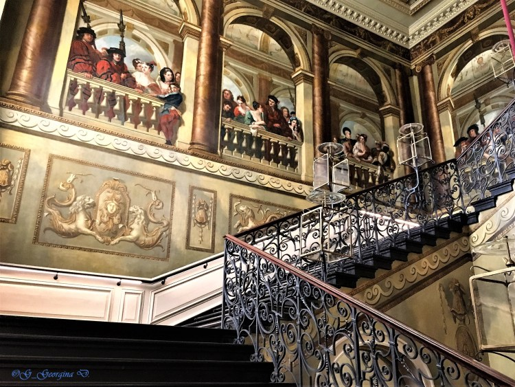 Kensington Palace: Kings Grand Staircase - The first link to the King's State Apartments. The walls surrounding the staircase was painted by William Kent in 1720, depicting George I's court.