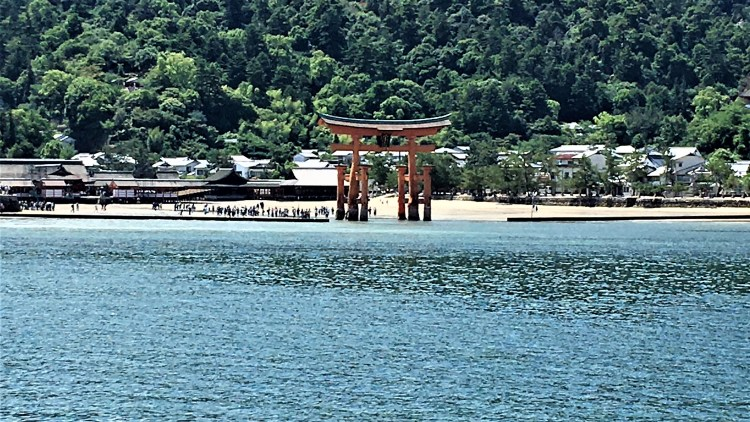 Miyajima Island: Visitors walk-up to the giant torii gate to have an up-close and personal look at this amazing structure.