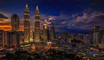Kuala Lumpur at dusk.   Charming City London