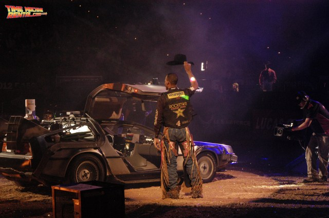 Valdiron de Oliveira tips waves his cowboy hat after exiting the DeLorean Time Machine rental car at the PBR Championships in Las Vegas, Nevada.