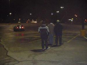 Film crew watching the car as our Doc Brown actor takes the car on a drive in the lot.