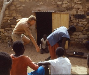 Living life to the full. The author, a little younger, gets dancing lessons in Dogon Mali,
