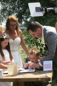 The young boy signing the marriage act