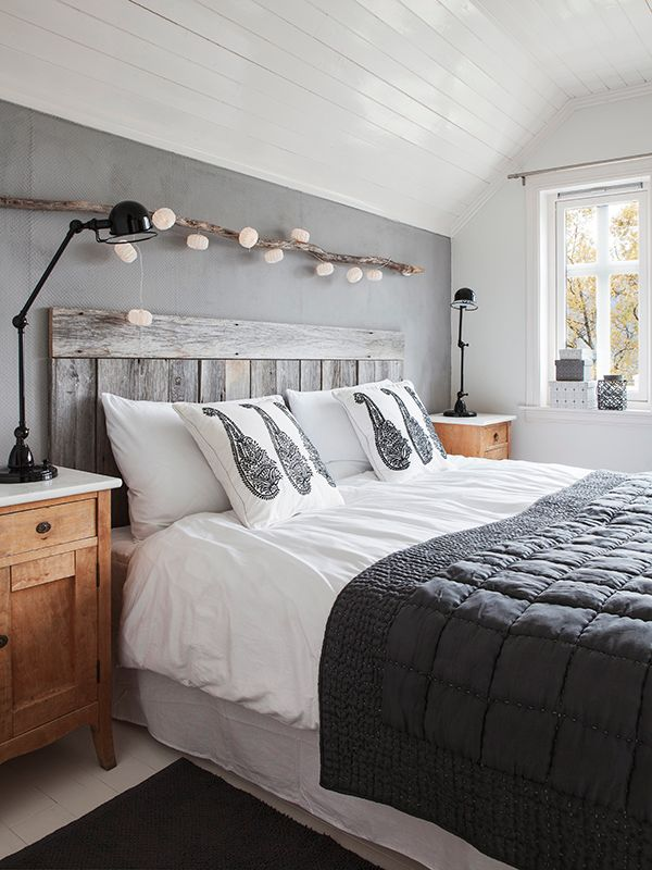 Decor your decent black and white bedroom with single string light over it to look your bedroom fabulous.