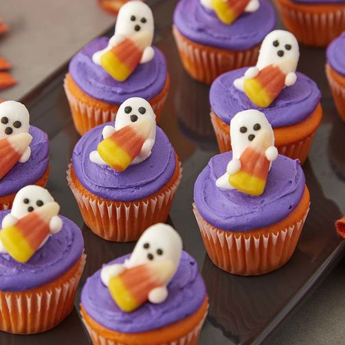 Ghost cupcakes treat for Halloween. Cute and easy Halloween dessert ideas. Halloween treat ideas for kids. Best cupcakes ghost recipes for Halloween party night. Candy corn treat for kids. Best Halloween cake ideas.