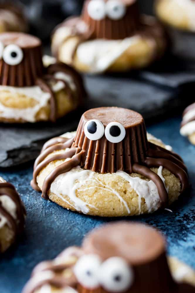 Funny spooky spider cookies for kids. Get 22 more Halloween party food ideas. Easy Halloween treat ideas. Easy Halloween dessert ideas for guest. Halloween spider cookies for kids. Easy to make Halloween spooky foods ideas for kids. Easy Halloween spooky food ideas for party. Easy Halloween treats for kids. Halloween treats for school parties. Halloween tricks and treats food ideas. Halloween food ideas for adults. Halloween homemade dessert idea. Halloween spider cookies for fun.