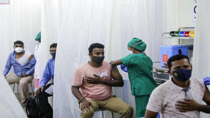 folks are administered COVID-19 vaccine in Mumbai.