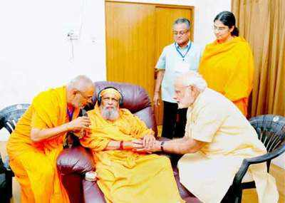 PM Modi s guru Swami Dayanand passes away   India News   Times of India File photo of PM Modi meeting his guru Swami Dayanand at his ashram in  Sheeshamjhadi area