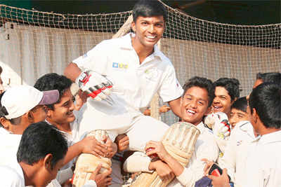 Pranav Dhanawade is lifted by his friends as they celebrate his world record 1009*. (PTI Photo)