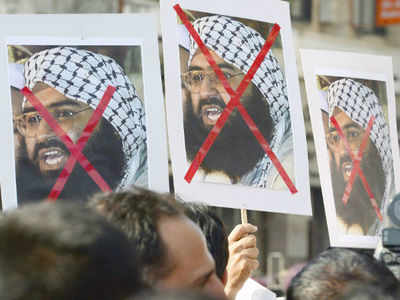 Protesters in Mumbai carry placards of Jaish chief Masood Azhar. (AFP file photo)