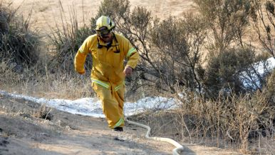 Firefighters make sure hot spots are out at Poinsettia Fire in Carlsbad.
