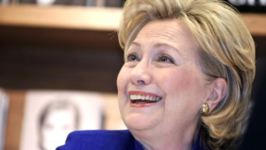 Hillary Clinton smiles at a book buyer at Warwick's.
