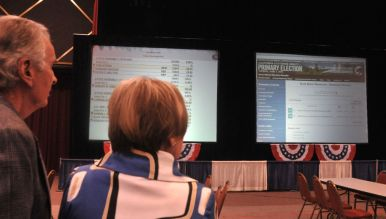 Golden Hall observers watched results posted from Registrar of Voters Office. Photo by Chris Stone